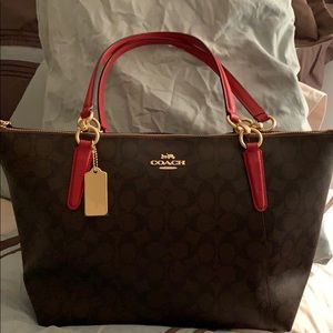 Brown with red strap Coach Tote.